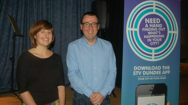 Happy winner-grin next to Head of STV Digital publishing, David Milne (image via @STVDundee)