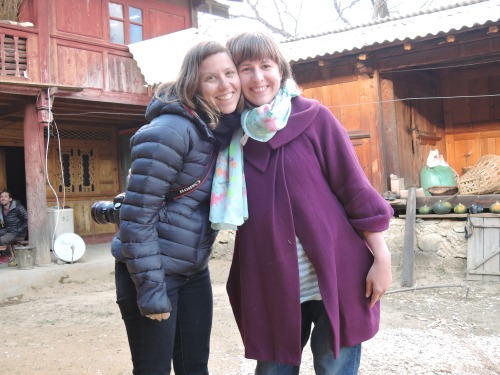 Samantha and I hanging out in a Naxi courtyard, halfway up a mountain in Southern China